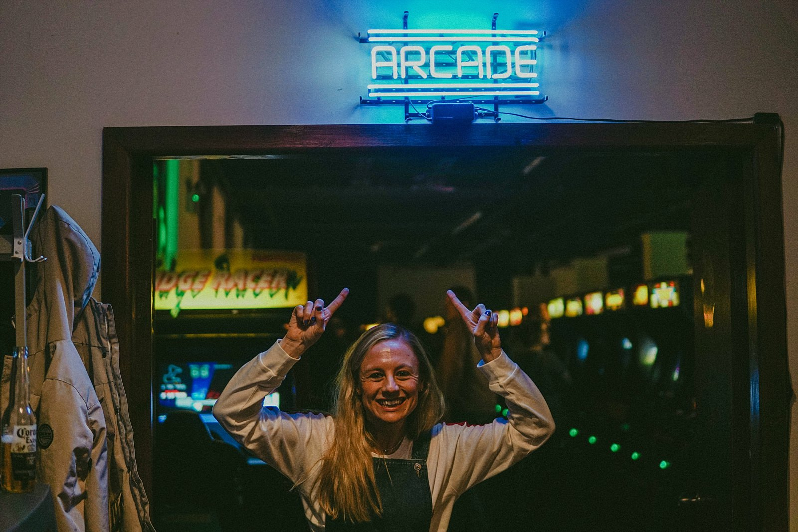 girl pointing to arcade sign