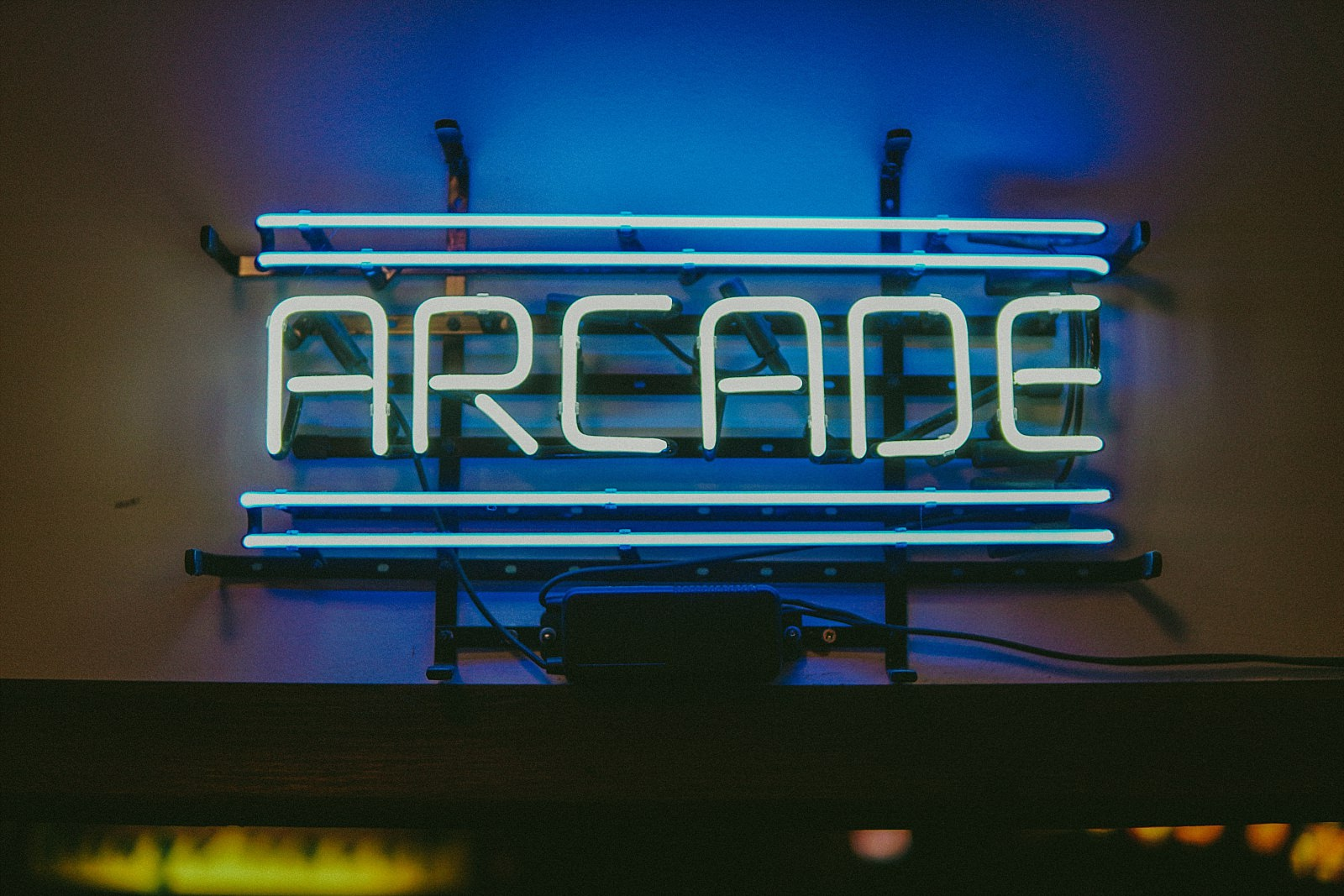 arcade sign in neon letters