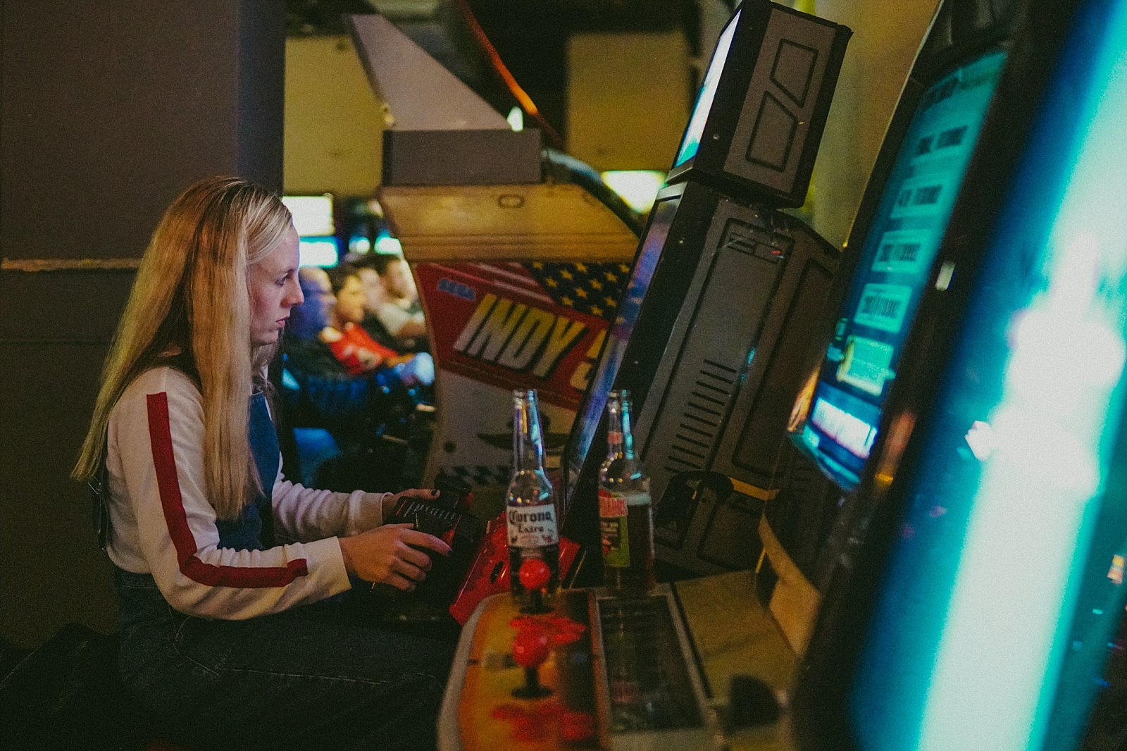 girl playing retro video game
