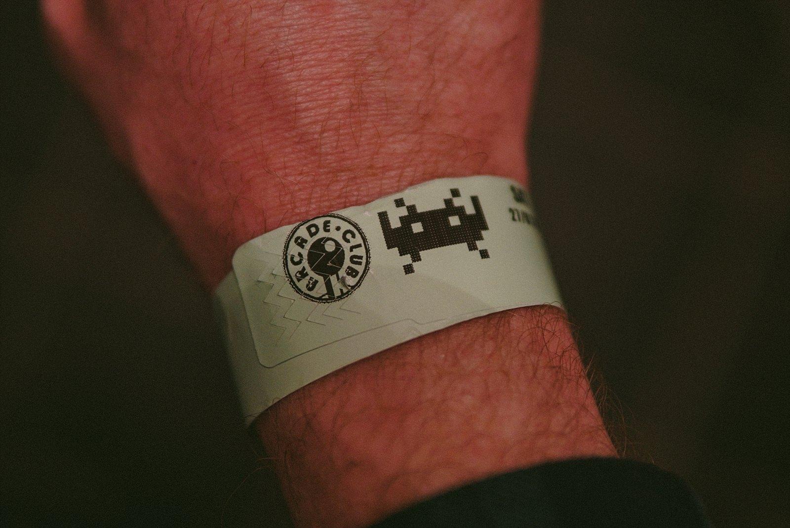 arcade club logo wristband