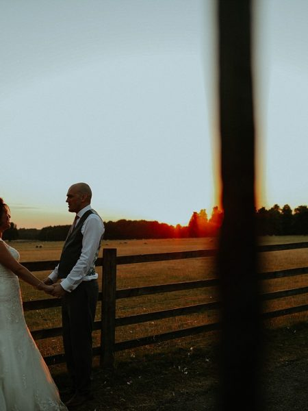 Knowsley Hall Wedding Photography shooting a sunset with a bride and groom