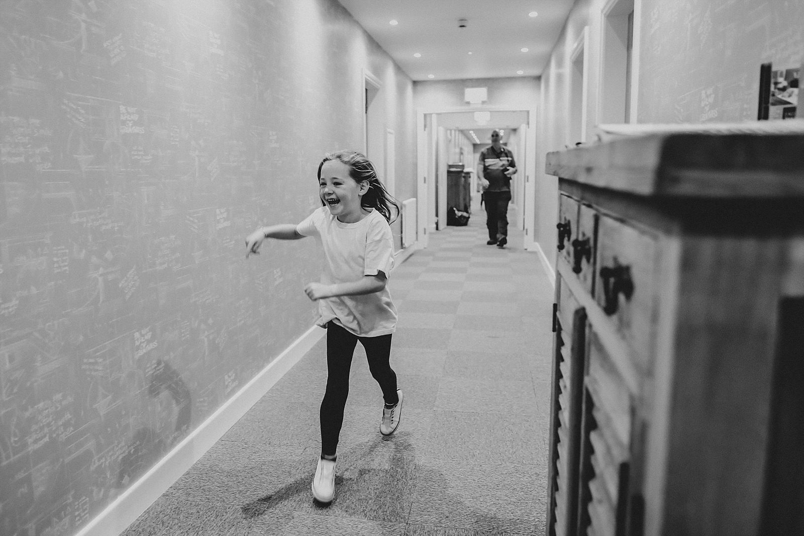 Bridesmaid running down the corridor at the spinning block