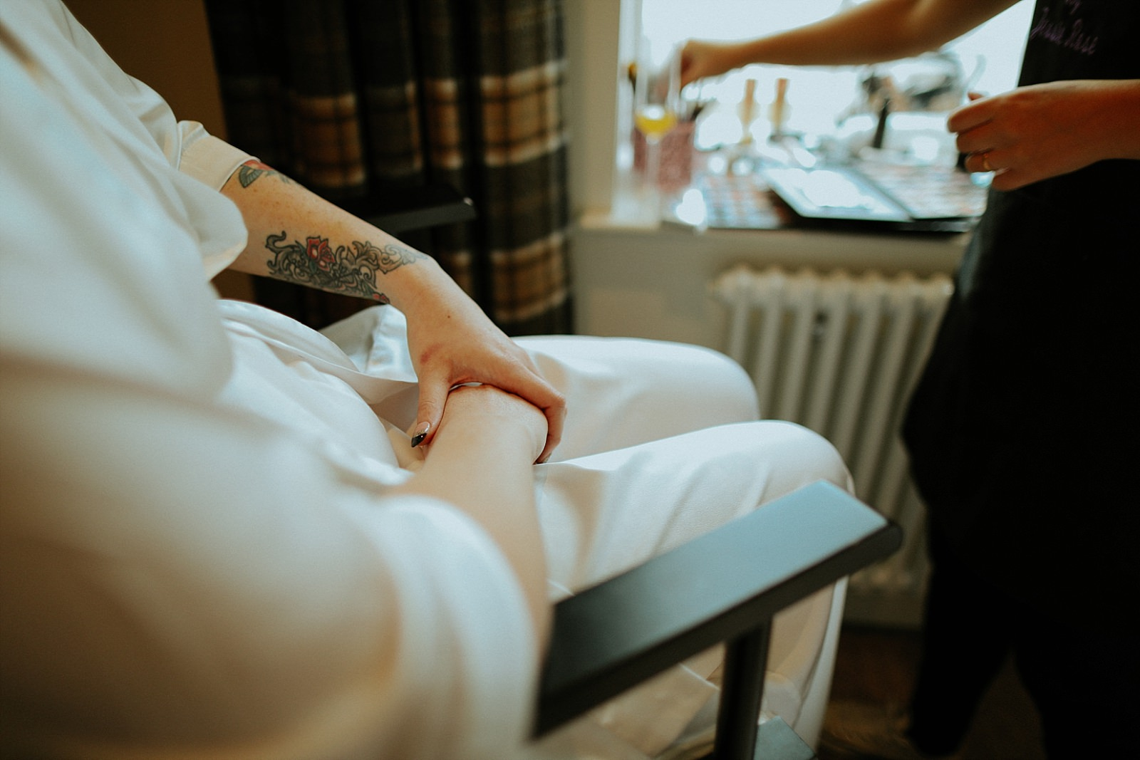 nervous brides hands with tattoos