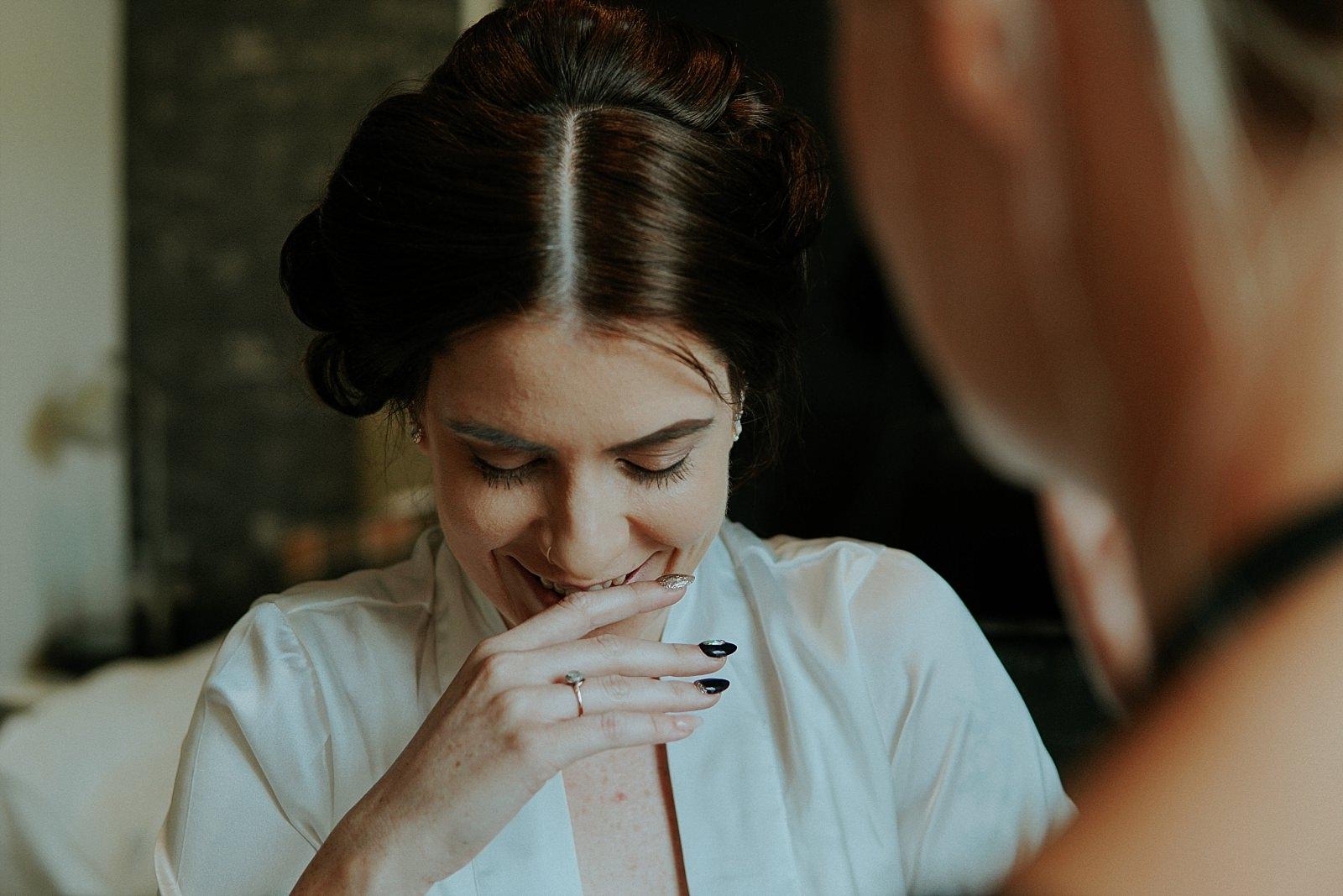 laughing bride during bridal prep