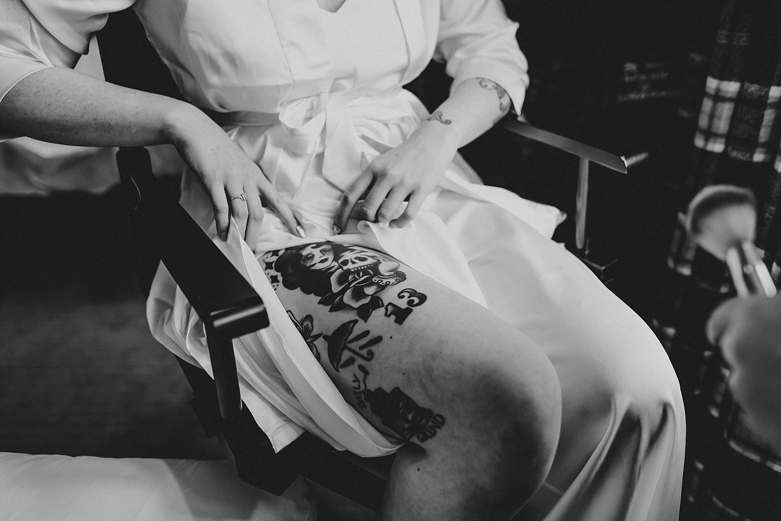 alternative tattooed bride revealing a new tattoo