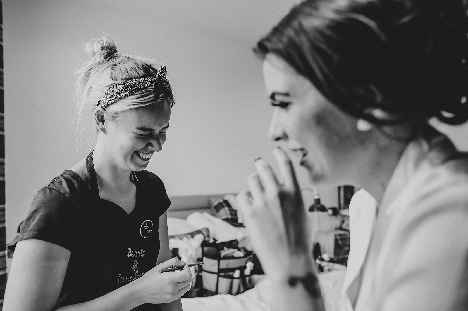 bride and make up artist laughing