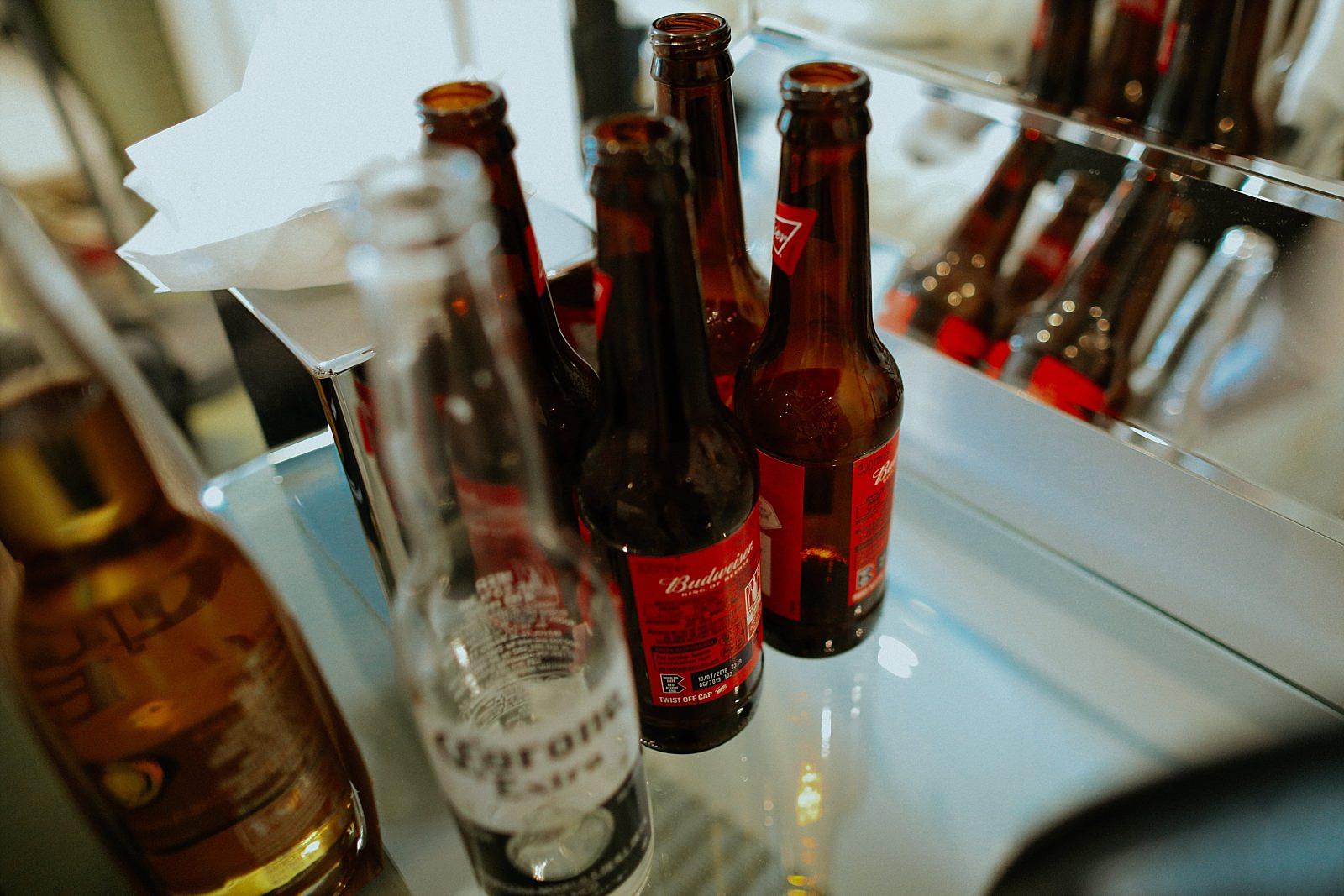 empty Budweiser bottle in groom prep