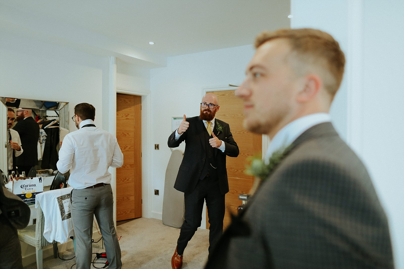 groom throwing thumbs up