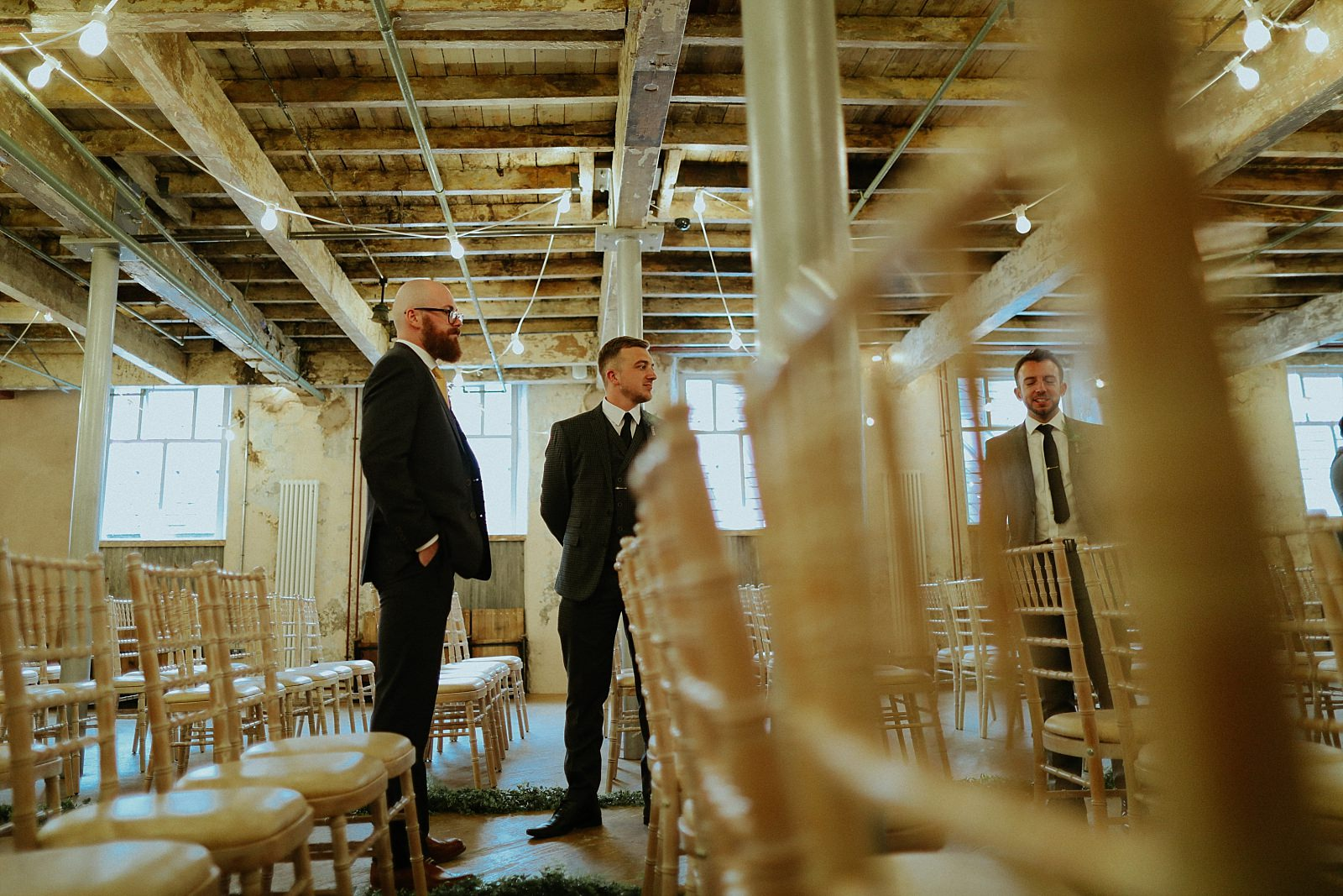 creative shot of groom in ceremony room