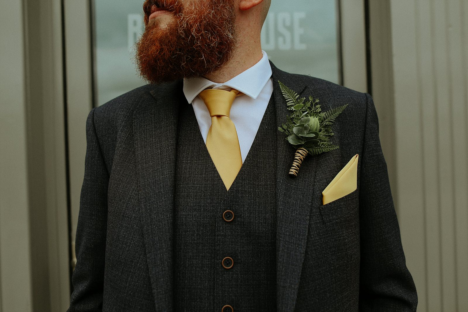 hop button hole and yellow tie for the groom