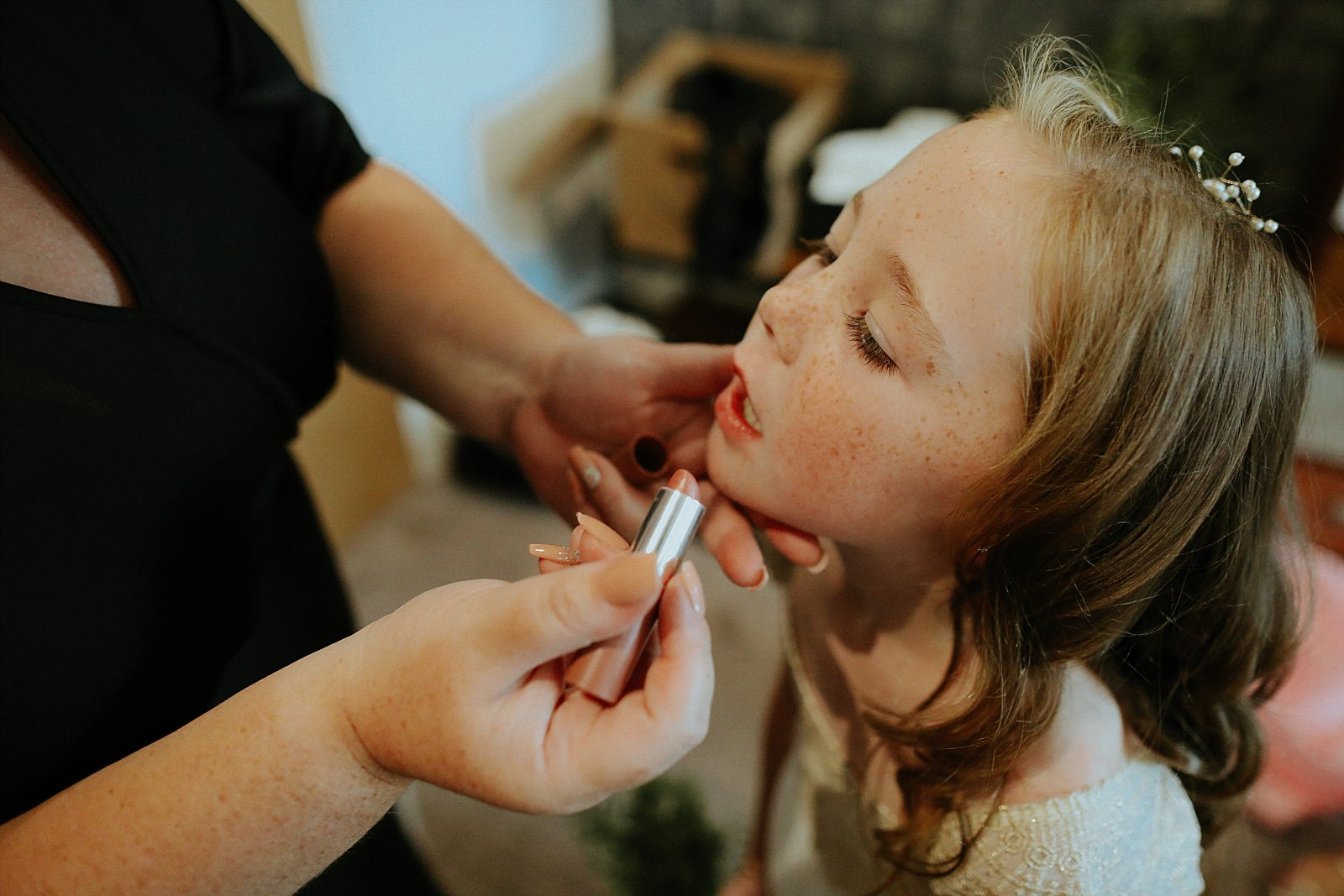 young bridesmaid having lipstick out on