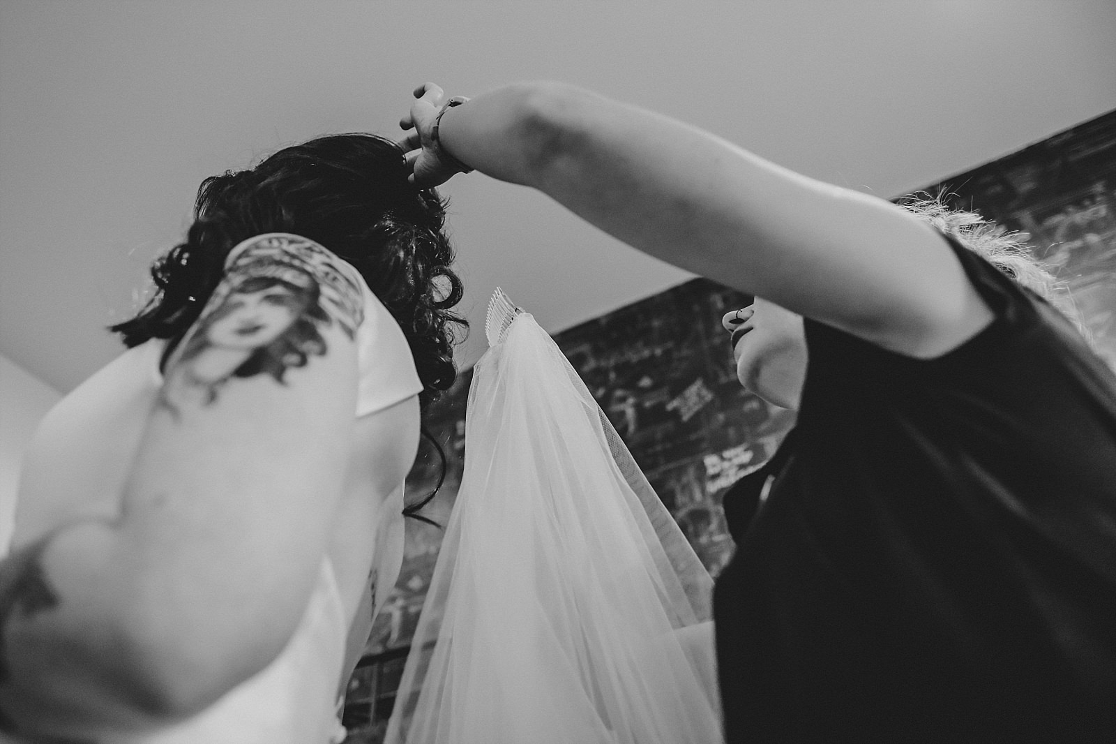 putting the veil on the bride