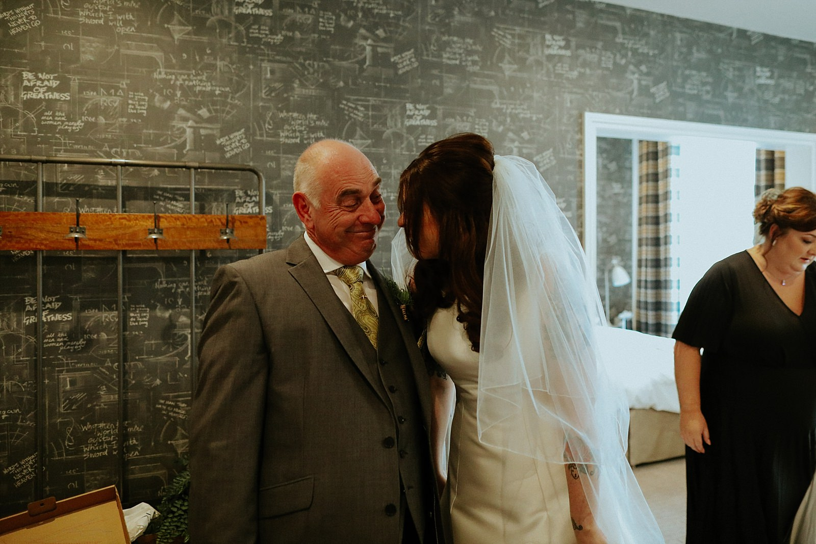 bride and dad laughing