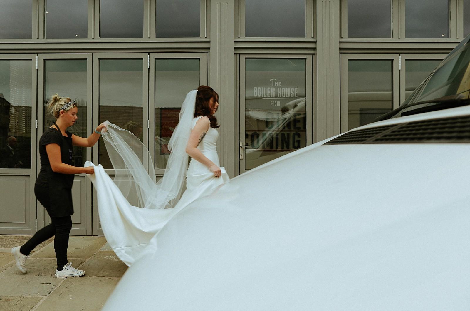 bride walking in white pronovias dress