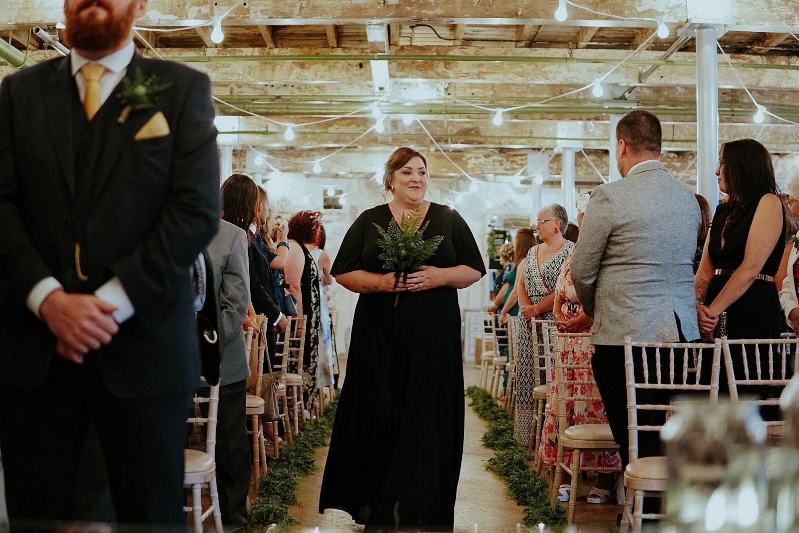 brides sister in black bridesmaids dress