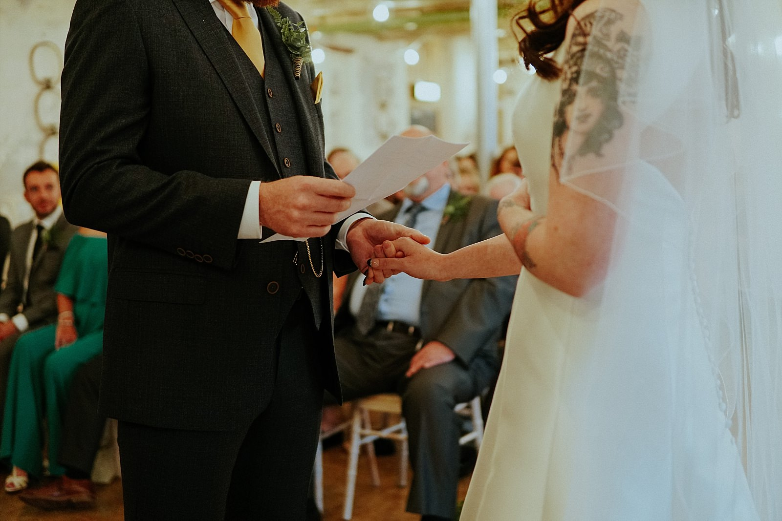 grooms reading his own vows