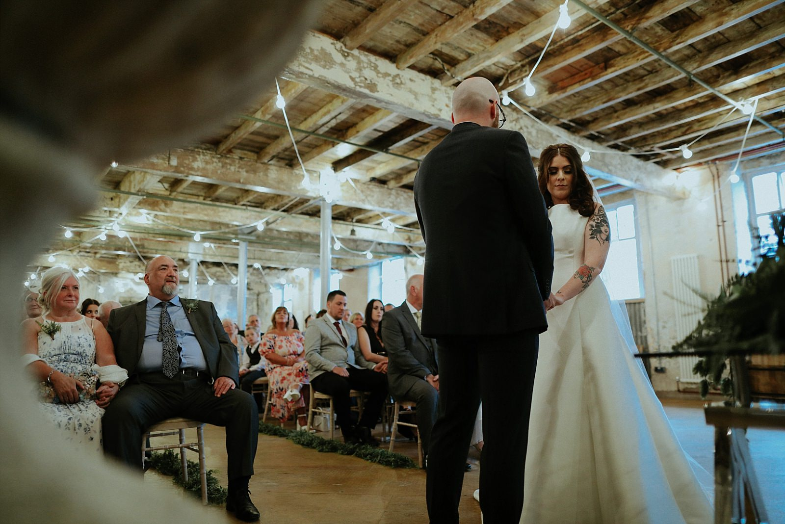 bride and groom getting married at holmes mill