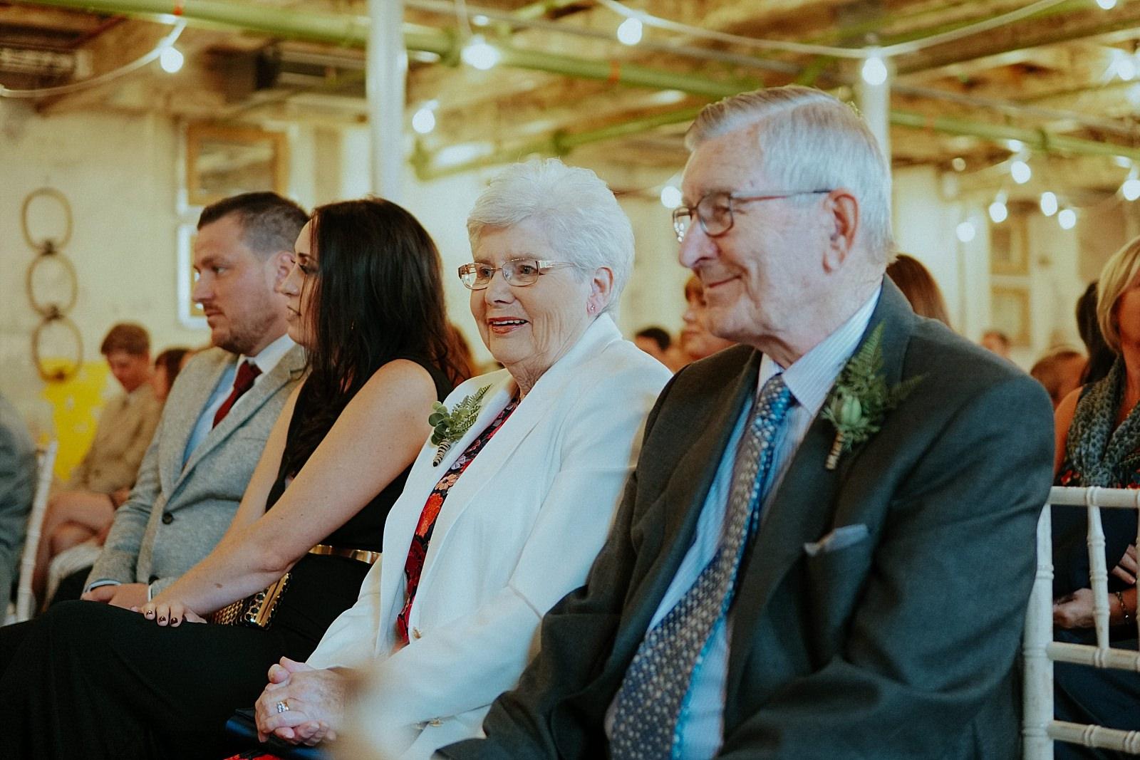 smiling grand parents