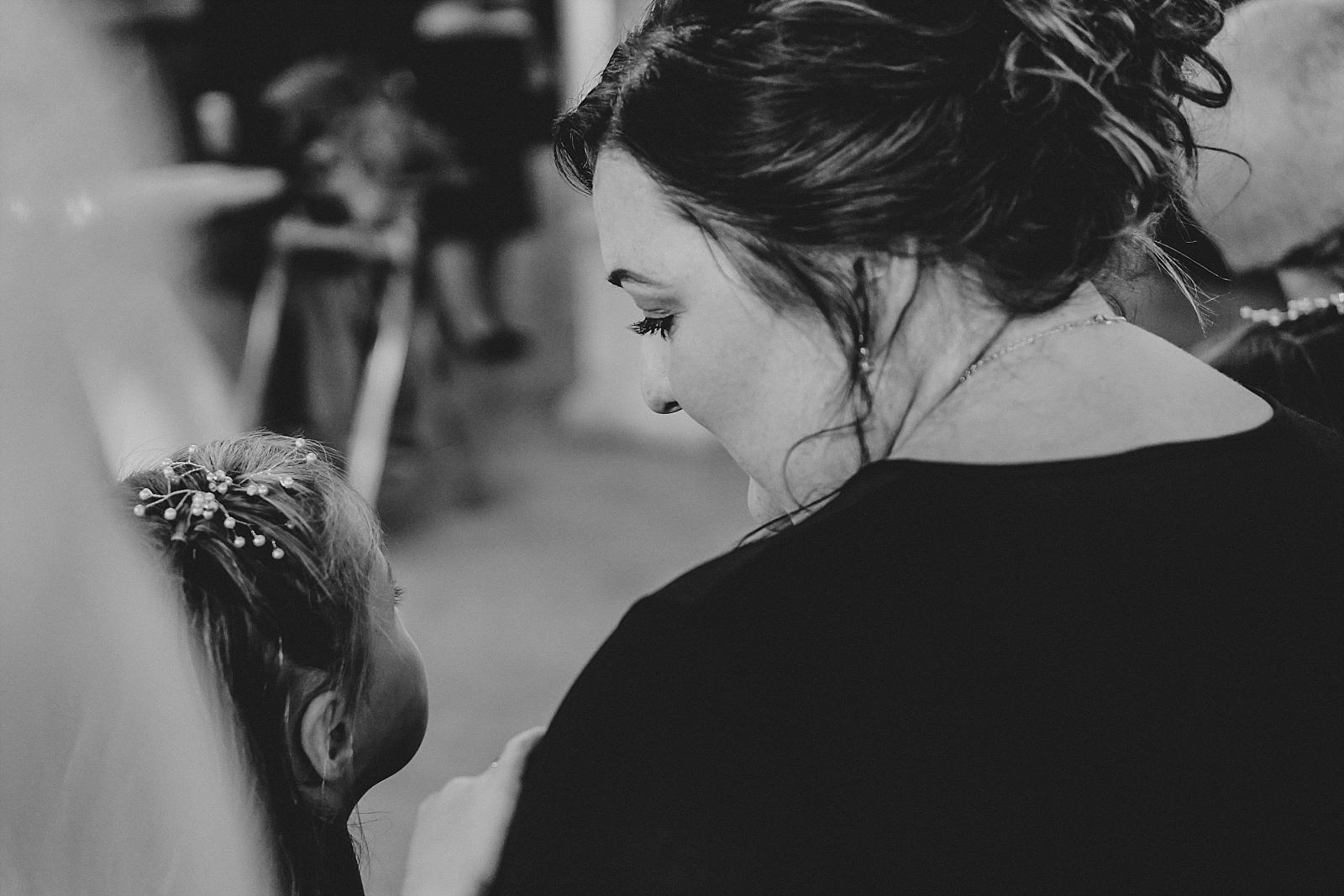 mum and daughter bridesmaids looking at each other