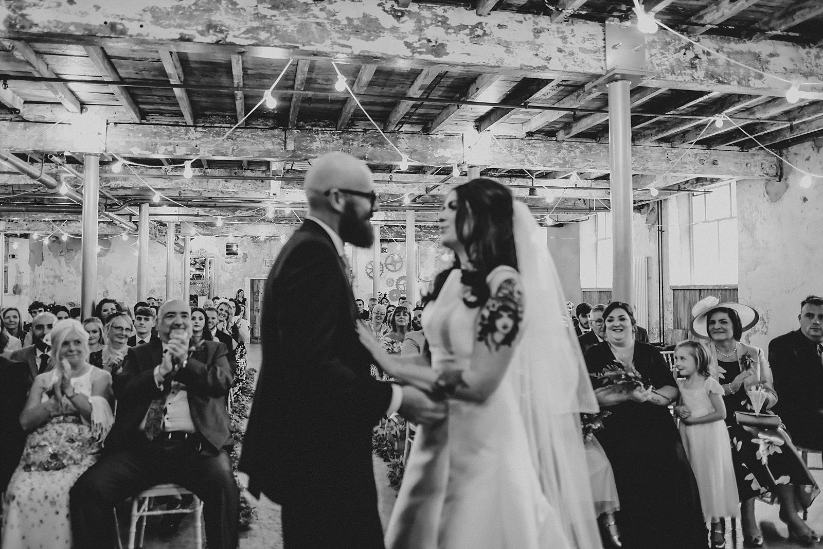 bride and groom in love in an industrial wedding venue