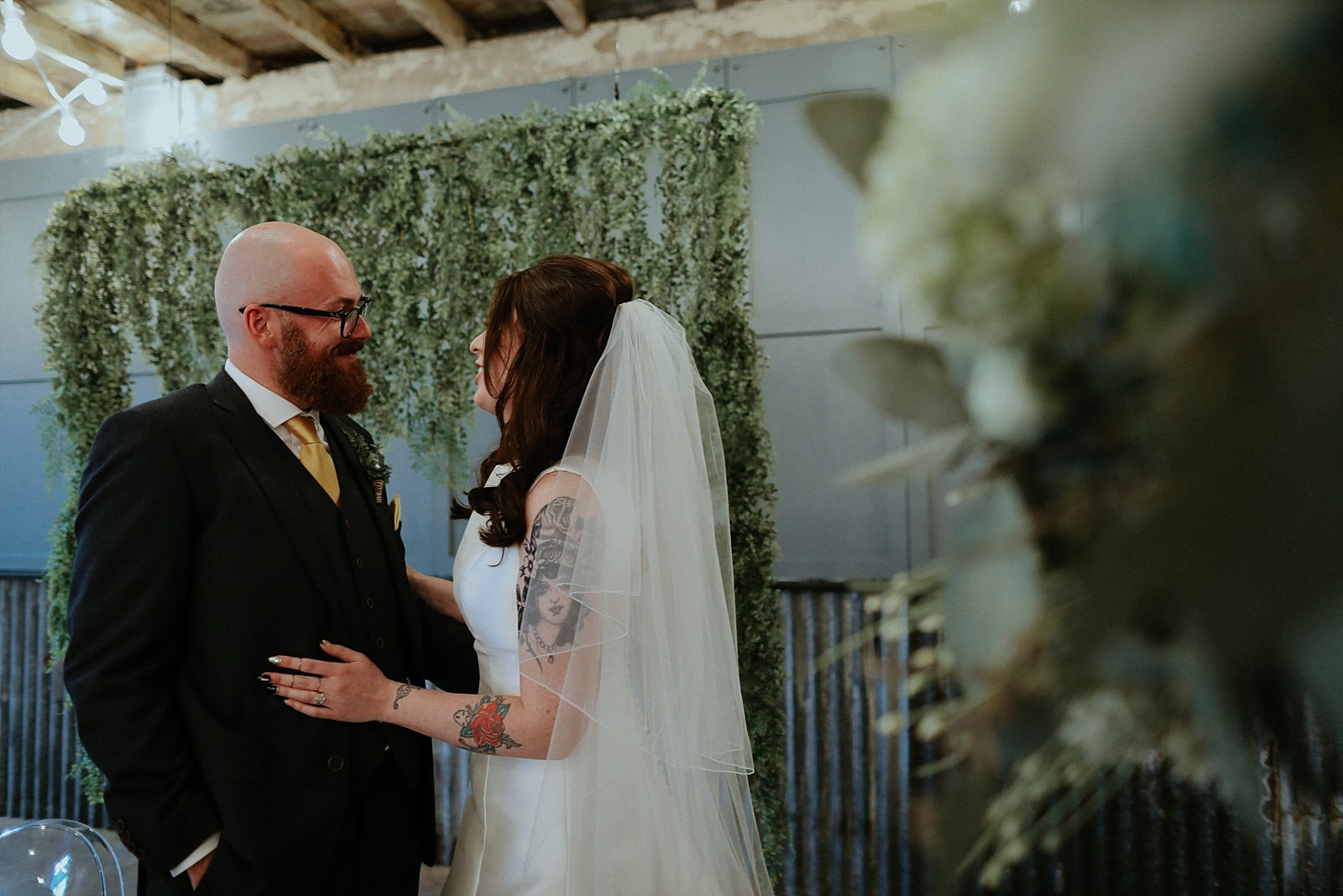 bride and groom together at an industrial wedding venue