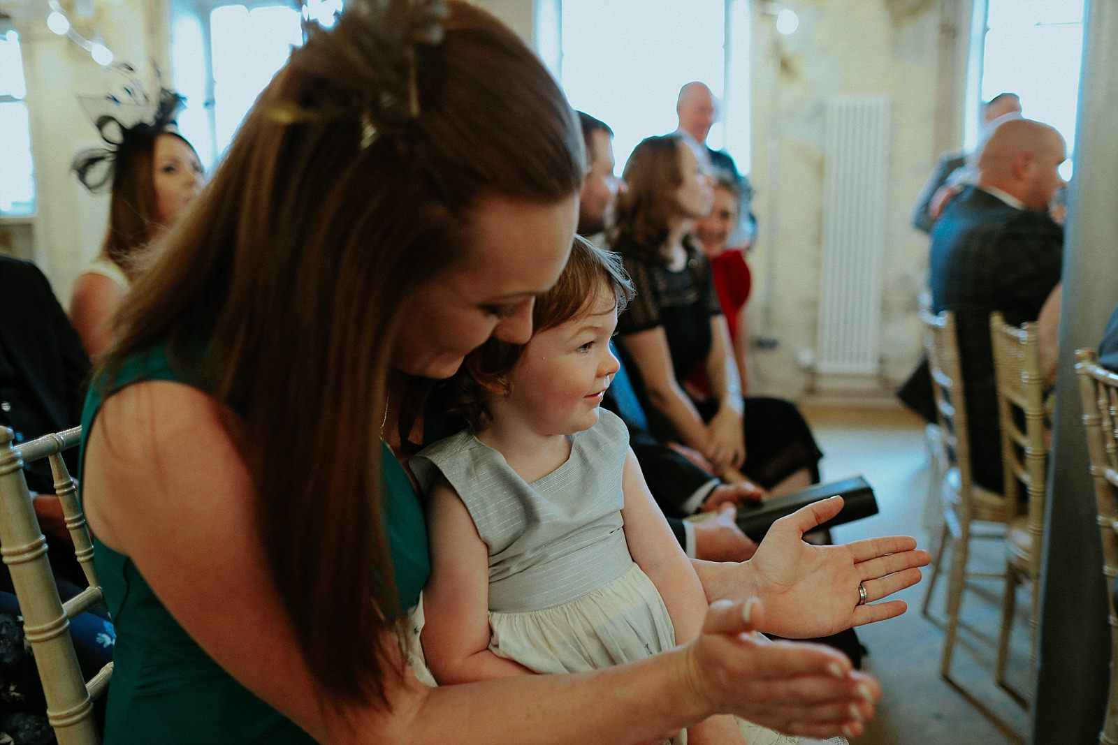 guest claps with her daughter at a wedding