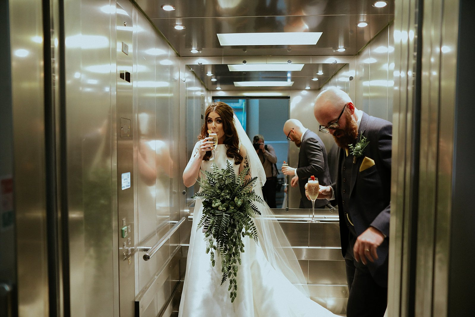bride and groom getting in a lift