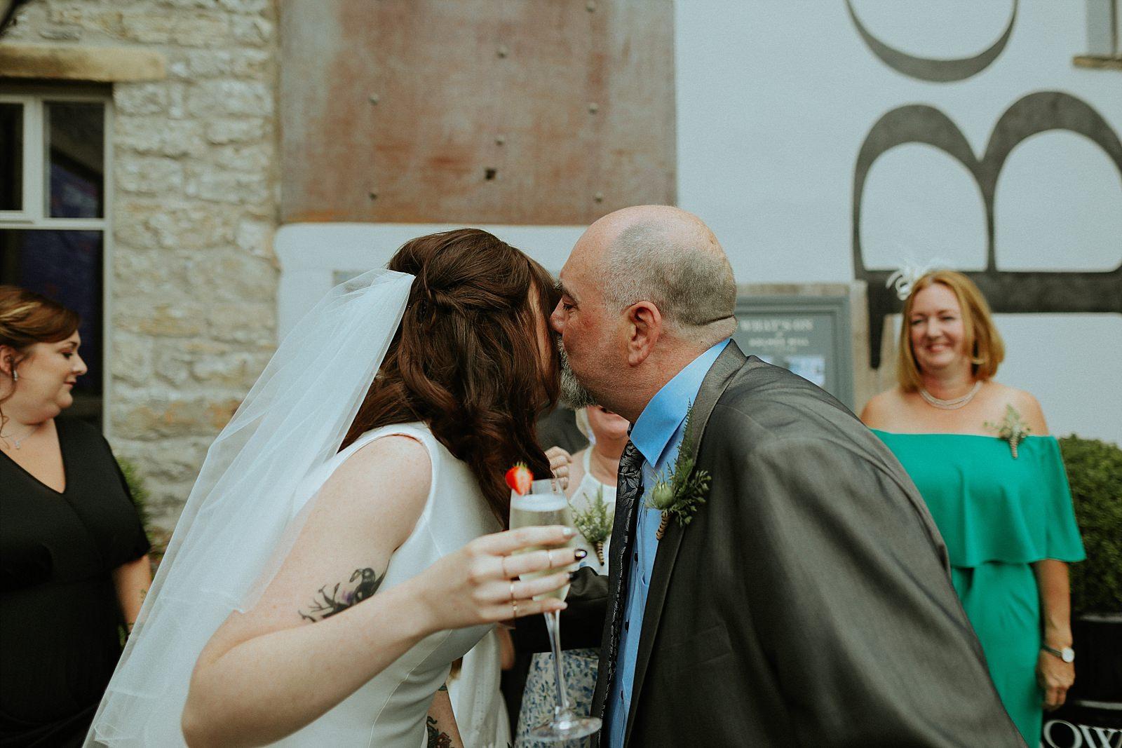 bride kissing guests