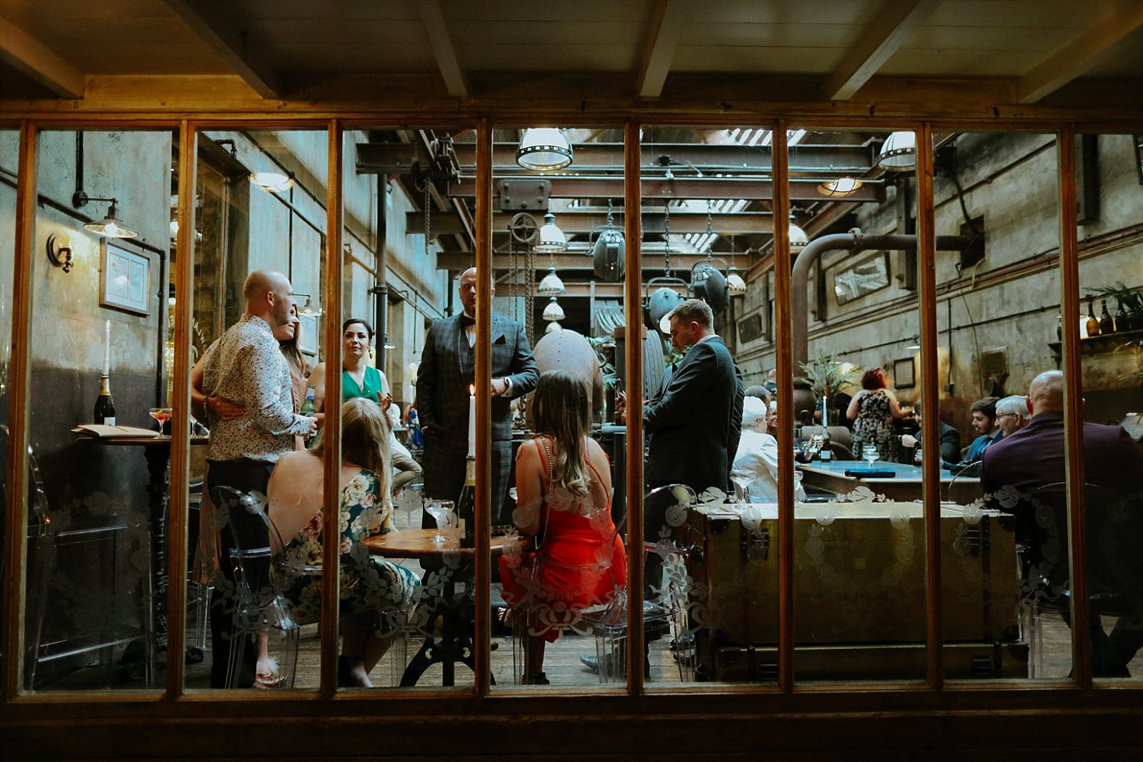 guests behind glass window at holmes mill