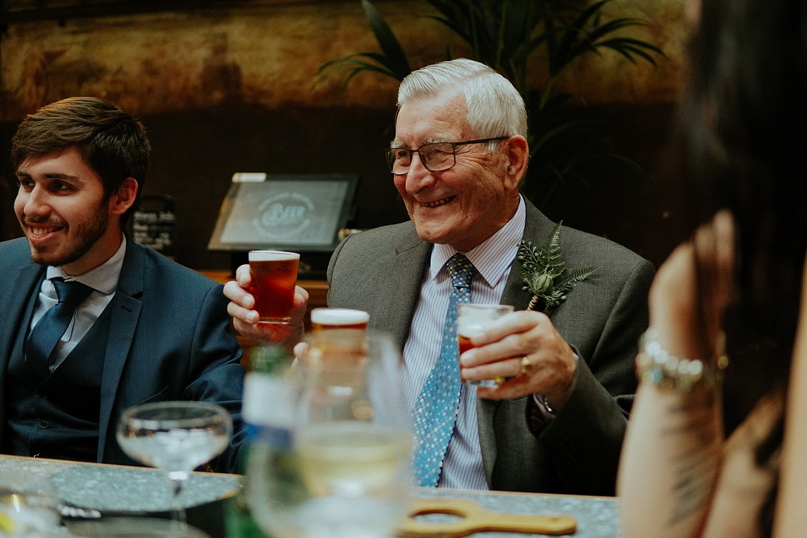 grandad holding up bowling beer