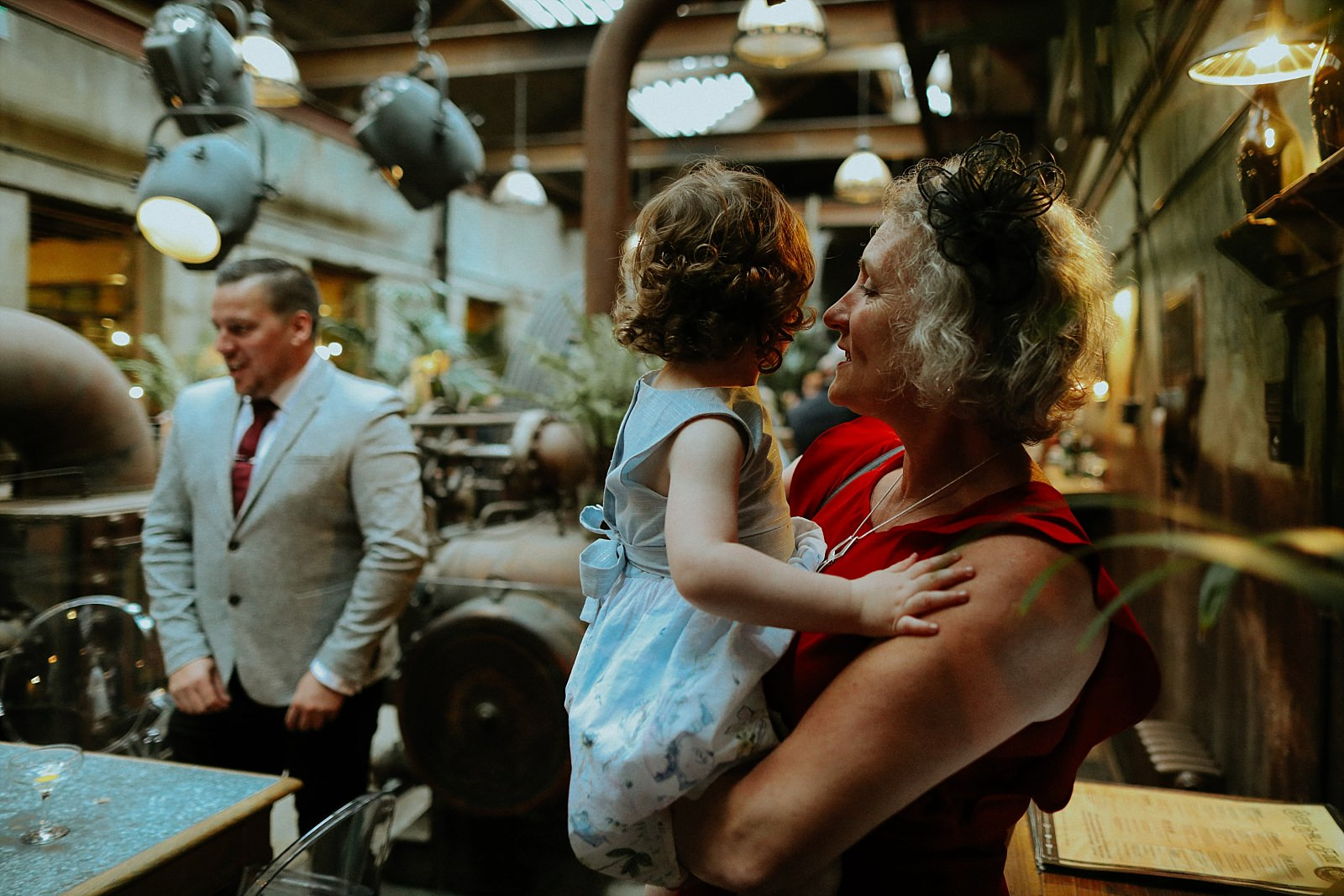 woman holding child at wedding venue