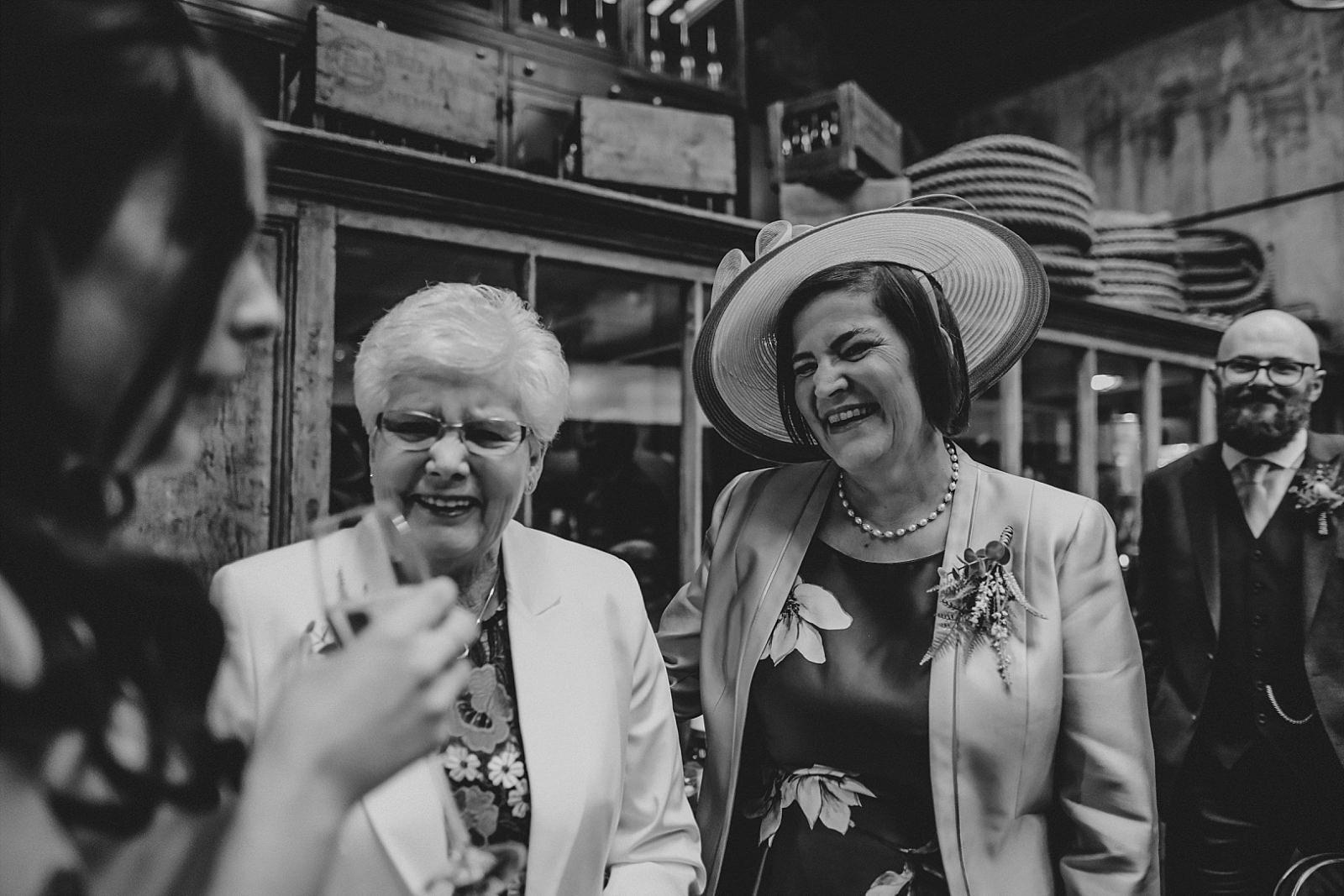 mum and grandma looking at bride