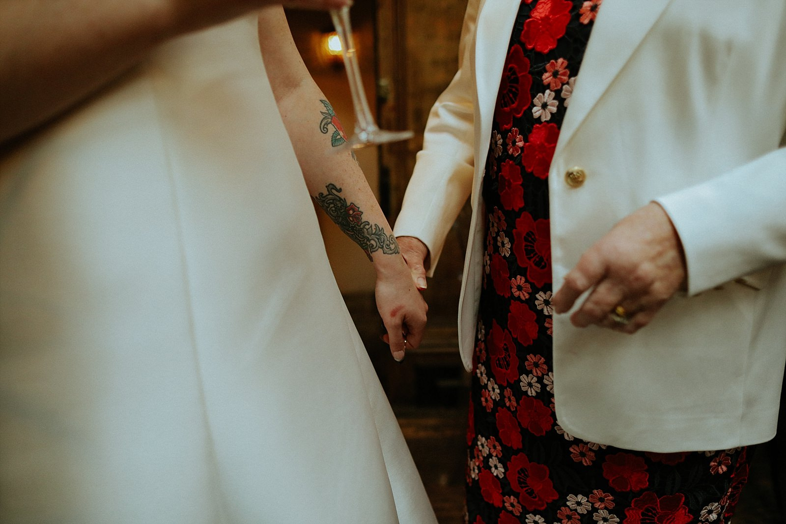 bride holding hands with grandparents