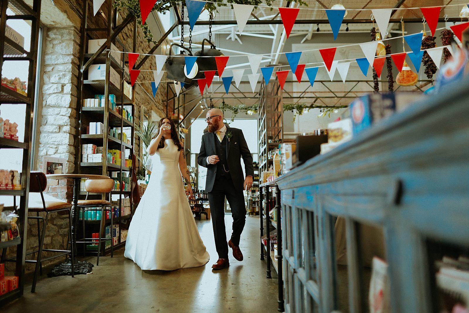 bride and groom walking in bowling food hall