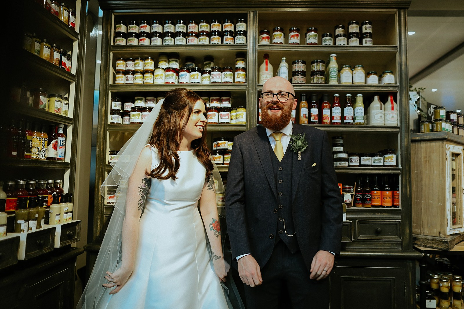 fun bride and groom in the food hall, clitheroe