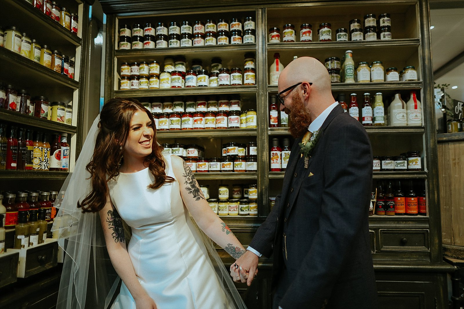 laughing bride and groom with food
