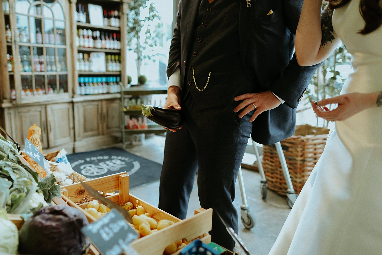 groom holding fruit as a penis