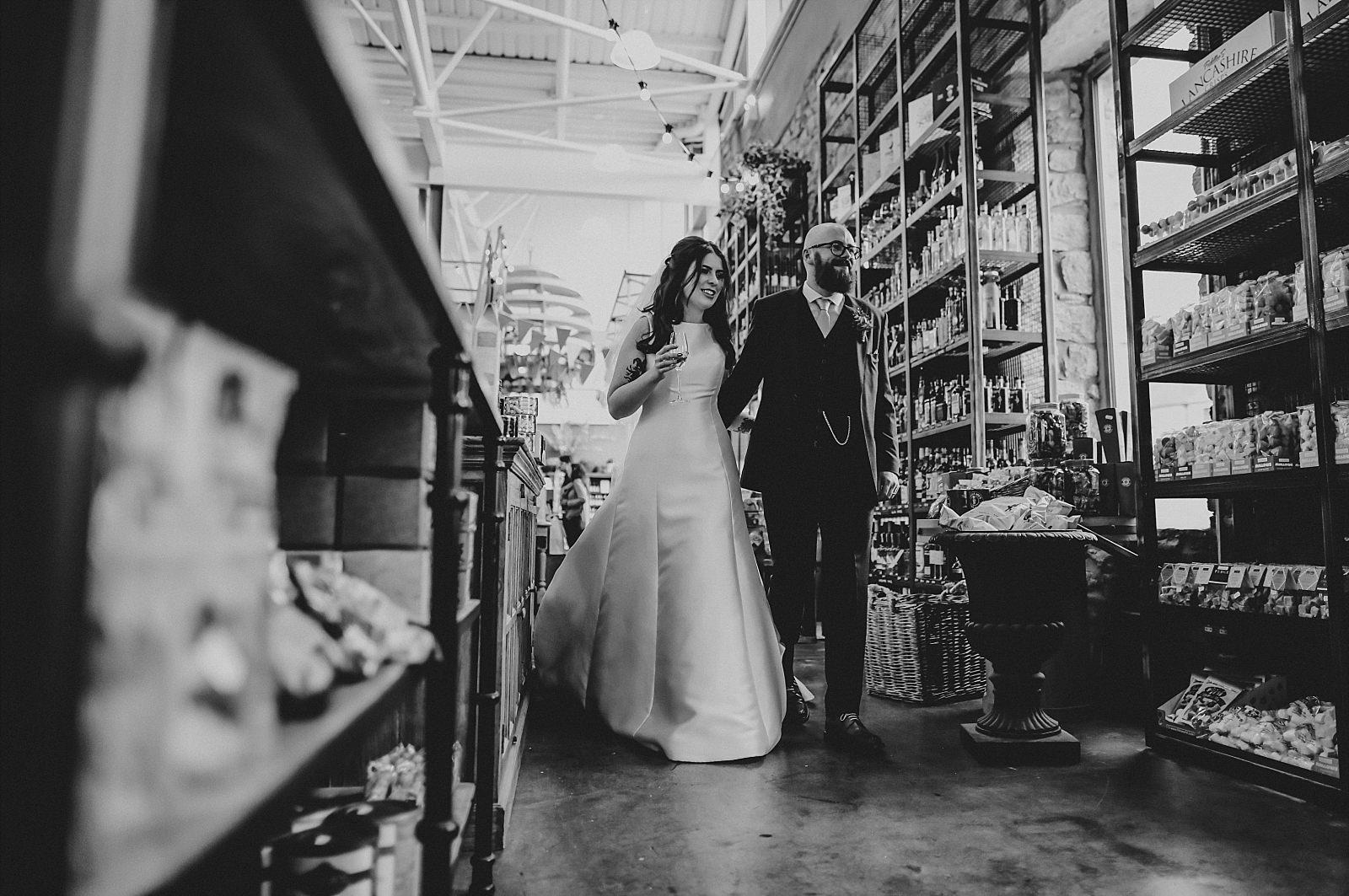 groom and bride walking hand in hand