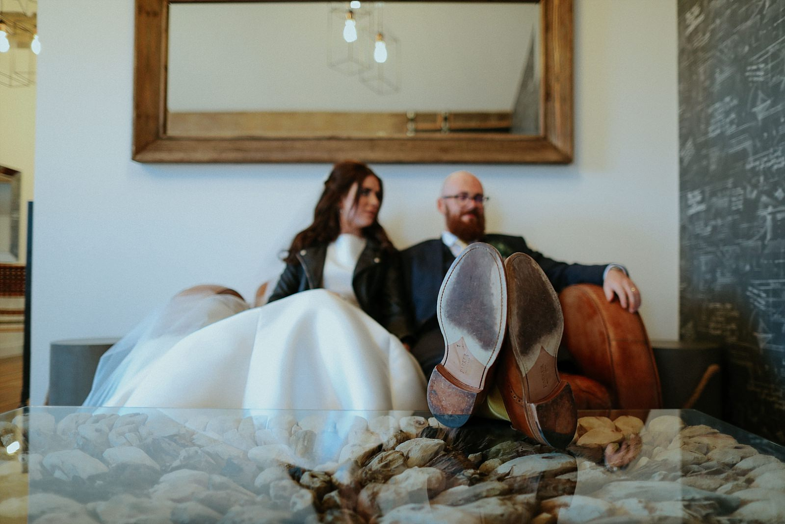 bride and groom chilling in holmes mill penthouse