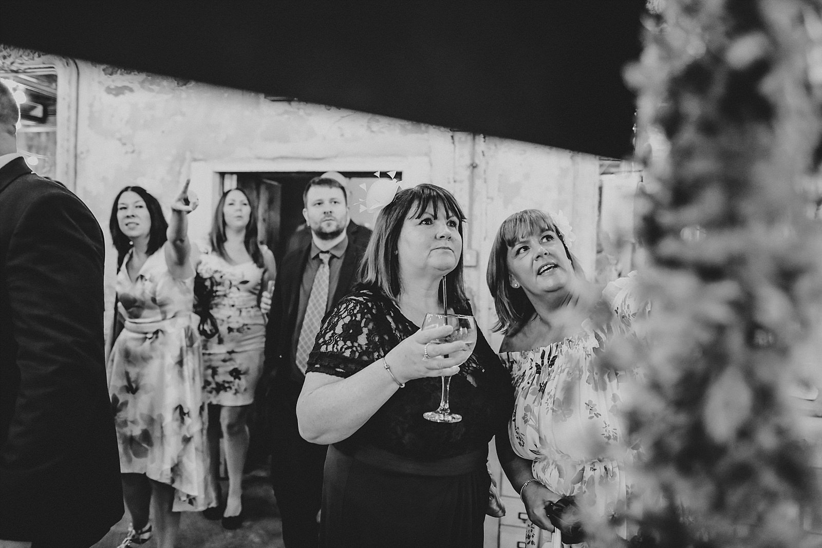 wedding guests reading the table plan