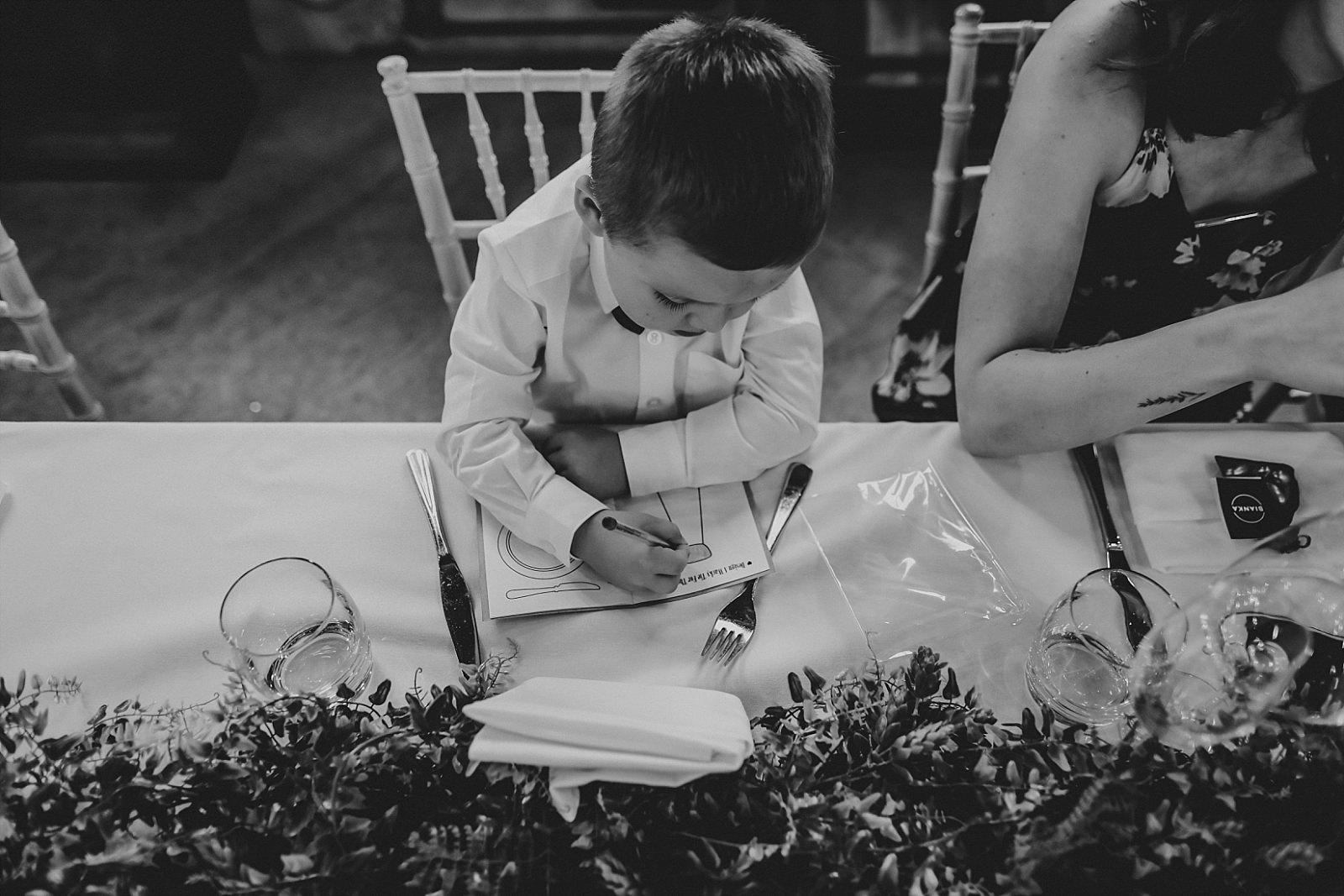 little boy colouring at a wedding