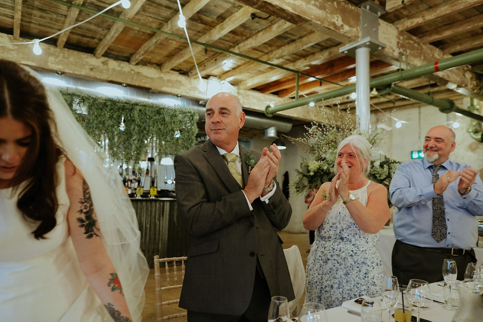 clapping father of the bride