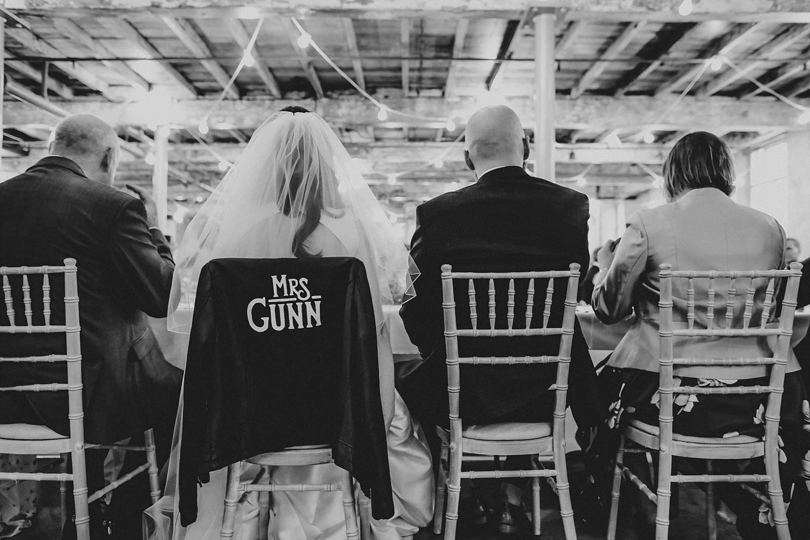 the back of the bride and groom during wedding breakfast