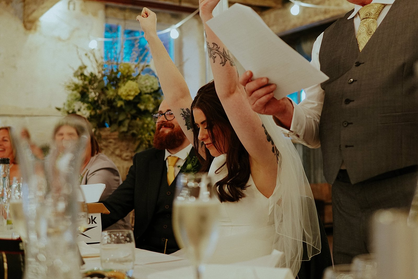 cheering bride during her wedding