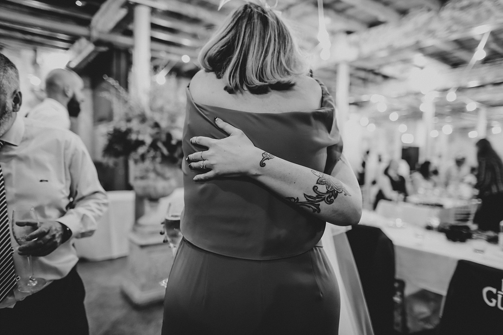 hugging and crying wedding guests