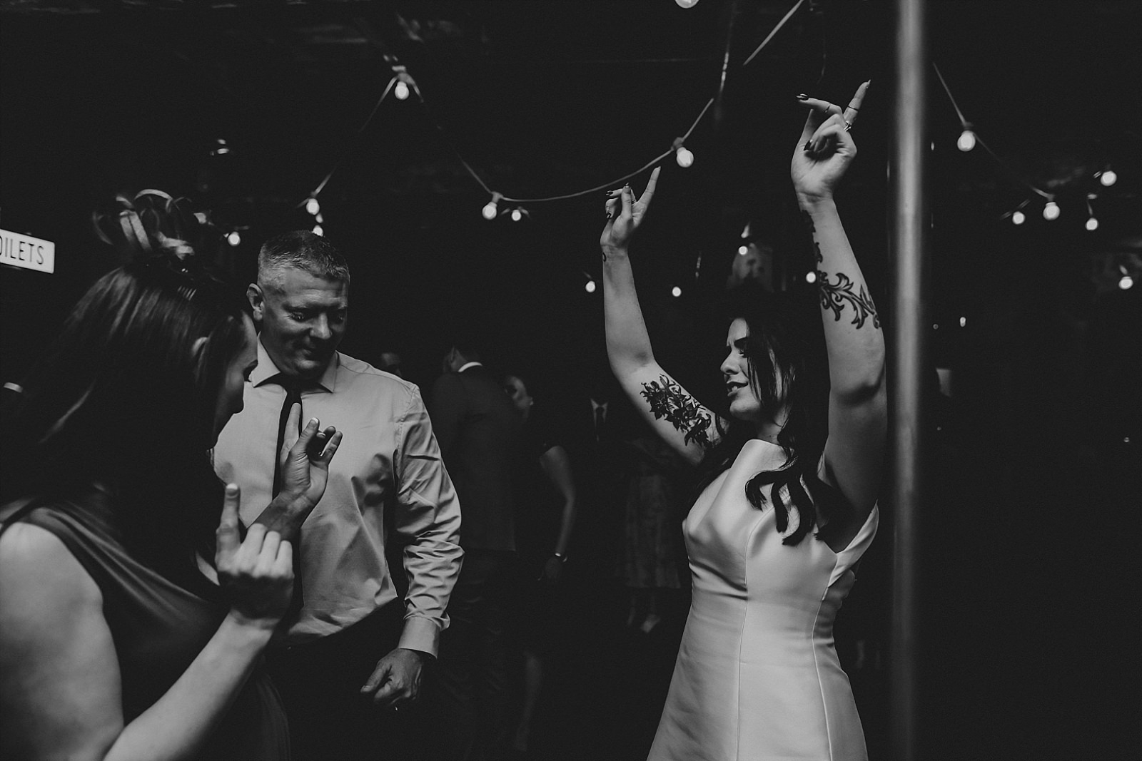 bride with hands in the air
