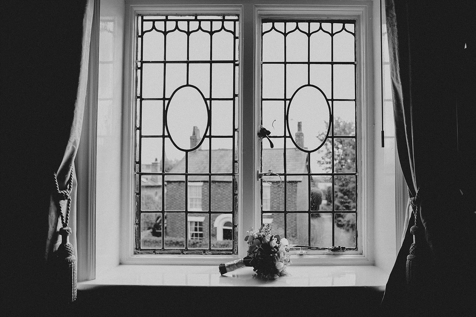 brides flowers sit on a window ledge