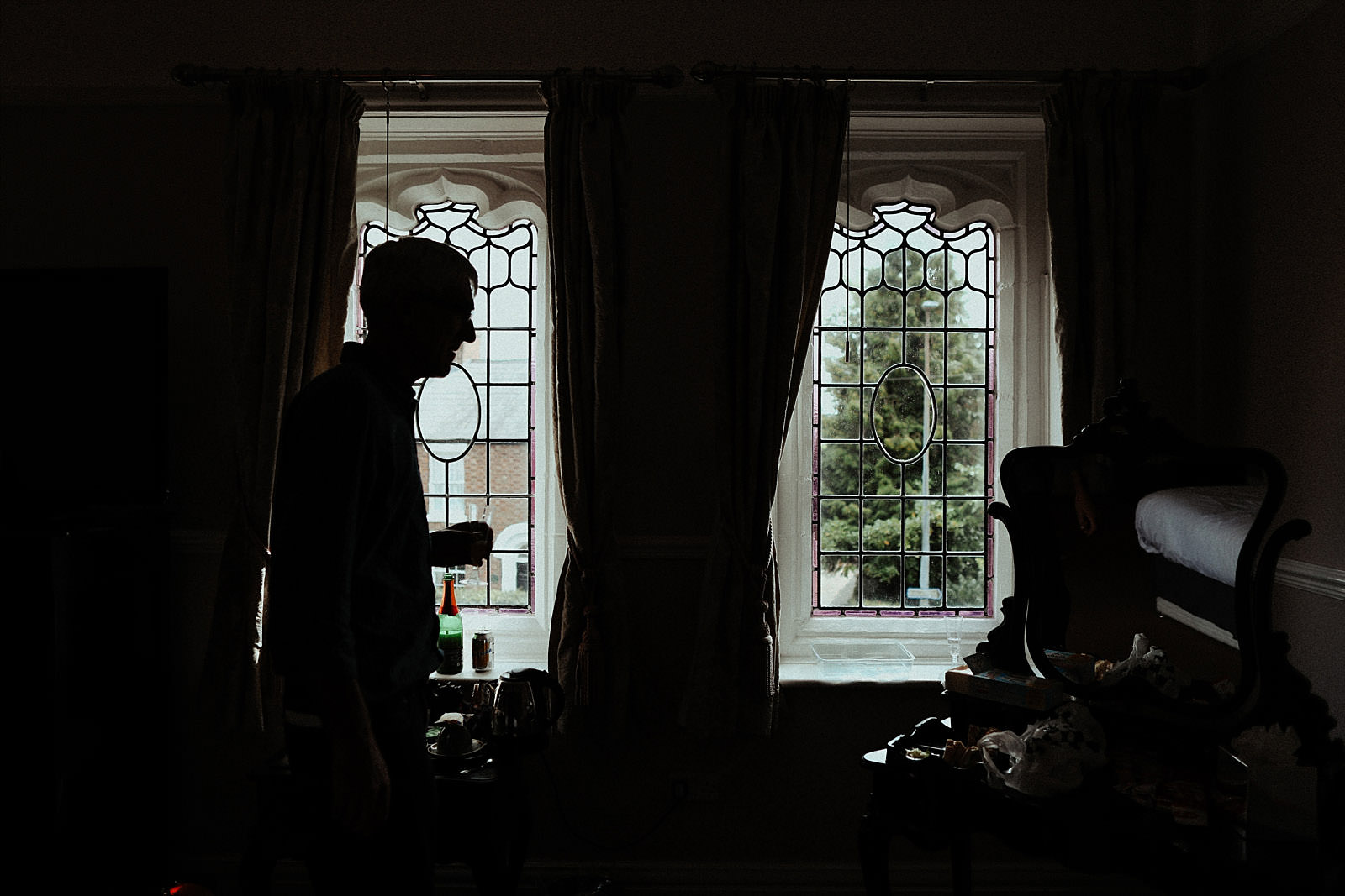 silhouetted dad by a window