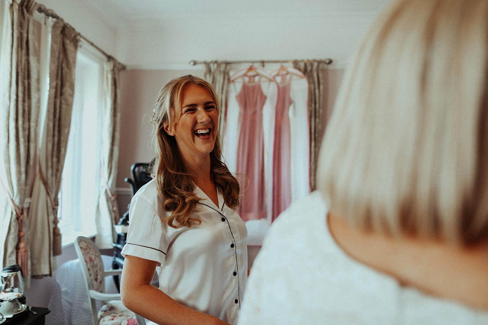 laughing bride at bridal prep