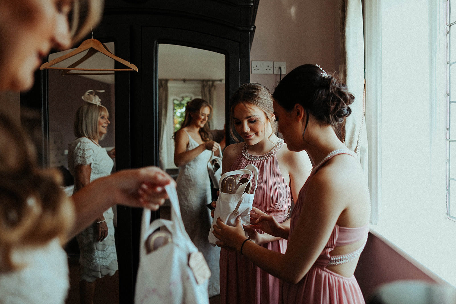 bride giving out her gist to her bridesmaids